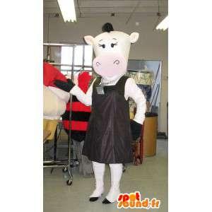 Lehmän maskotti muodikas mannekiini valepuvussa