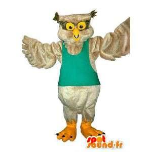 Mascotte hibou de couleur beige, déguisement d'oiseau