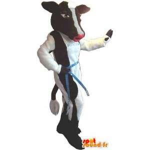 Lehmän maskotti näyttää mannekiini, lehmä puku