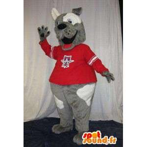 Bicolor Hund Maskottchen hält Fan-Kostüm Bär