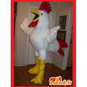 Mascot wat neerkomt op een kip, haan kostuum