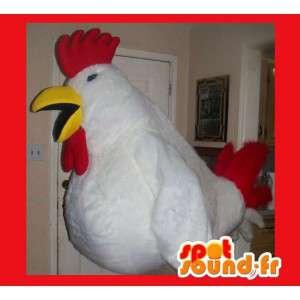 Mascot wat neerkomt op een grote haan, kip kostuum