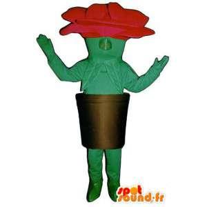 Mascot formet rosa rød og grønn gigant i sin pott