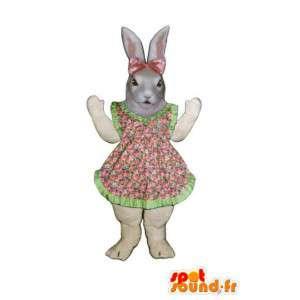 Pasqua vestito della mascotte coniglio con fiori rosa e verde