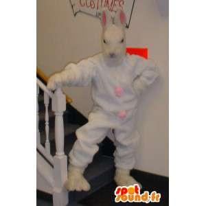 λευκό μασκότ κουνελιών και γιγαντιαία ροζ - φορεσιά κουνέλι