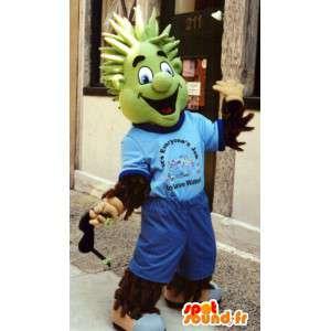 Mascote homem peludo vestida de azul com uma cabeça verde