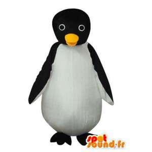 Mascota del pingüino negro blanco con pico amarillo