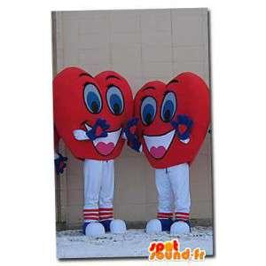 Maskoter formet hjerter. Pakke med 2 dresser hjerte