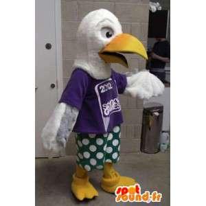 Maskotti jättiläinen valkoinen lintu pukeutunut vihreä ja violetti